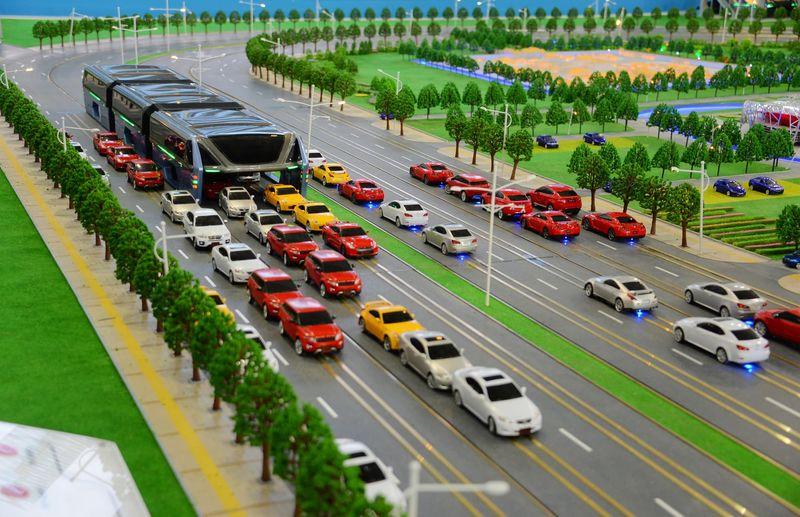 Road-Straddling Buses