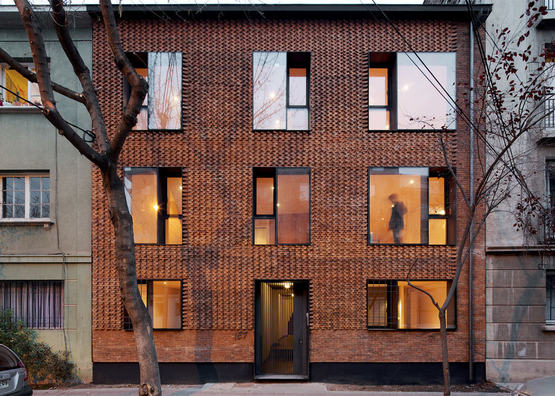 Textured brick buildings textured brick for Brick facade house