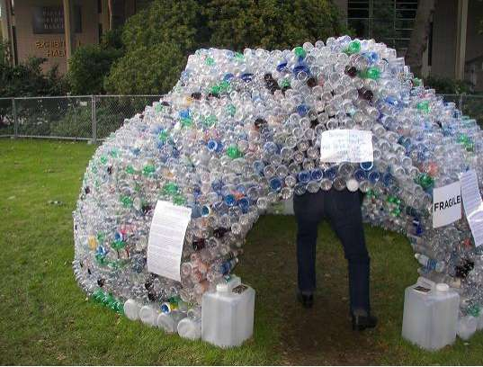 Houses made of plastic bottles jasmine zimmerman 39 s bumbershoot art - Building a house with plastic bottles ...