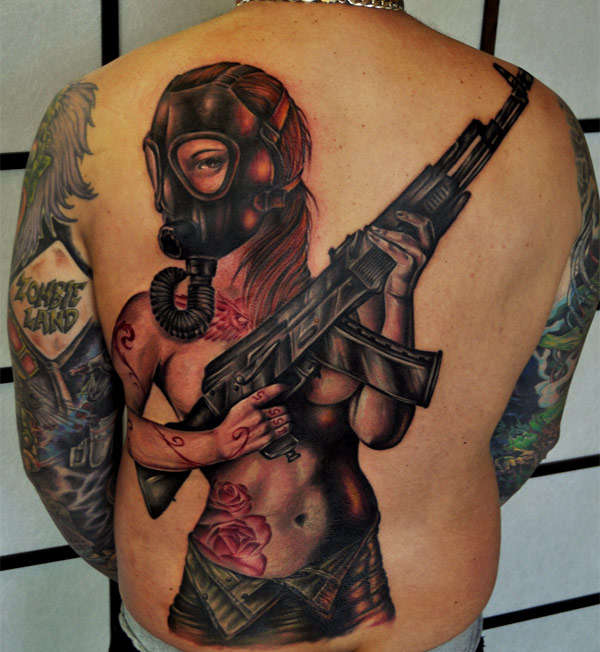 Zombie combating body art walking dead inspired tattoo for Ak tattoo gun