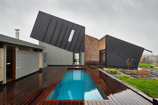 Tilted carbon neutral architecture zero energy house for Zero energy house design