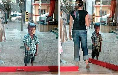Guerilla Awareness - Child Poverty Ads in India: Begging Child on Glass