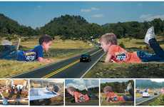 Giant Kid Billboards - The Hot Wheels Child-Shaped Structures are Advertised on the Highway