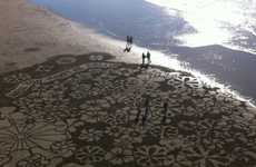 Sandwritten Proposals - Andres Amador Creates Huge Beach Mural to Help a Client Pop the Question