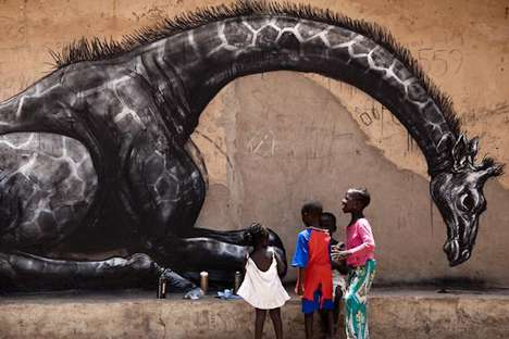 Artist Roa in Gambia Creates Charitable Street Art
