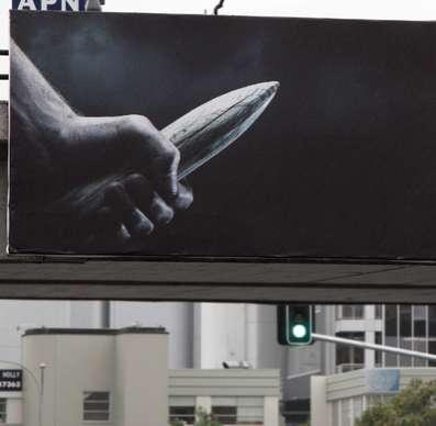 Precariously Phallic Billboards