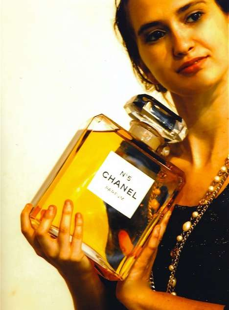 Oversized Bottle Captures - Alex Solomon Poses with a Colossal Chanel No. 5