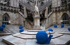 Blue Snail Installations - REgeneration by Cracking Art Group Crawls Over the Duomo Cathedral