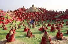 AIDS Awareness Santas - Artist Creates 500 Sandtas on the Beach to Educate People on Cultural Issues