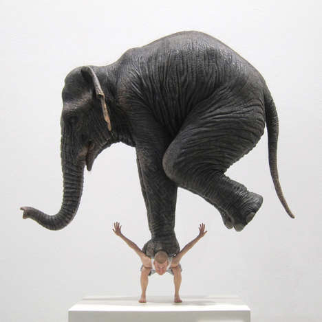 This Surreal Sculpture Features an Elephant Standing on Fabien Mér