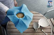 Coffee-Holding Cloth Ads - The SPA Sponge Cloth Ad Showcases the Strength of This Household Product
