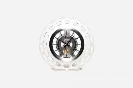 Lavish Perforated Clocks - The Hermes x Jaeger LeCoultre 'Atmos' Glass Clock is Filled With Gas