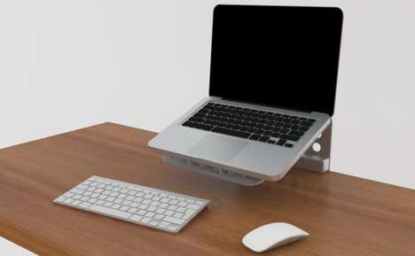 Space-Saving Computer Platforms - Laptop Stand Frees Up the Area Beneath it for Other Desktop Items