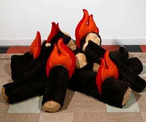 Cozy Campfire Plushies - These Playfully Stuffed Fire Logs Bring the Warmth of Outdoor Living Inside