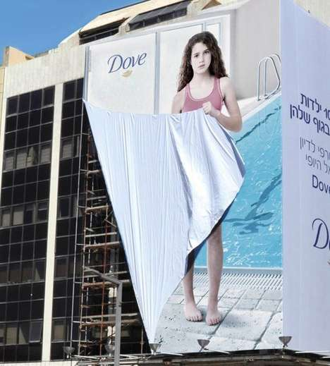 Self-Conscious Billboard Ads - The Dove 'Girl Outdoor' Ad Has a Girl Hiding Using the Ad Itself