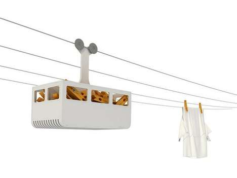 This Clothespin Holder Hangs off Your Clothes Line Like a Cable Car