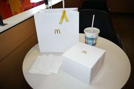 Lavish Fast Food Packaging - McDonald's Adopts Minimal Packaging for Its Luxury Burger Series