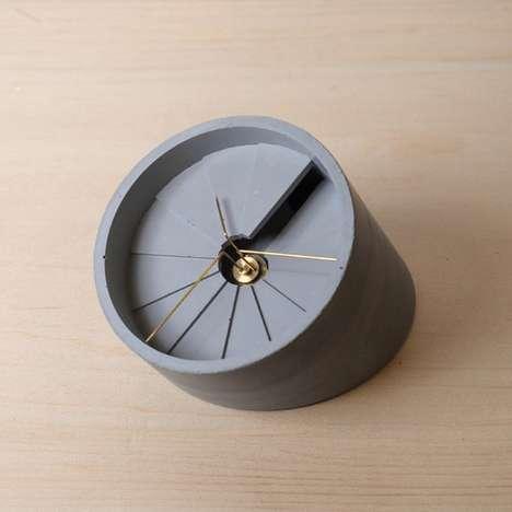 Spiraling Asymmetrical Concrete Clocks