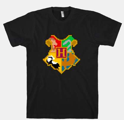 8-Bit Hogwarts Shirts - This Fantasy Novel Attire is Perfect for Gamers Too