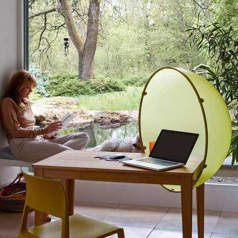 The Vitra Sphere Table Helps to Conceal Those Working