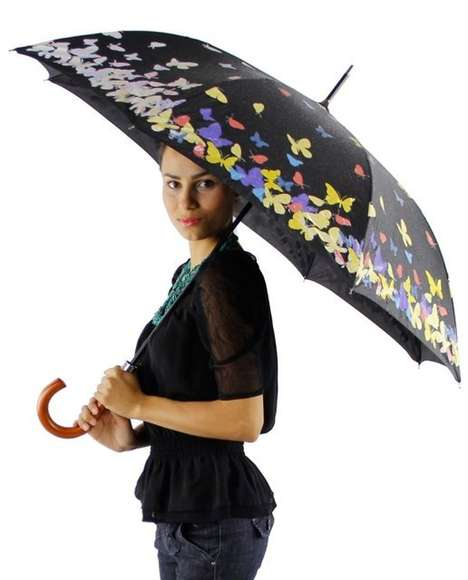 The Color Changing Umbrella is Embossed with Colorful Butterflies