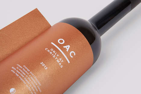 Tabbed Bottle Branding - OAC Liqueur Packaging Features a Tag for Scribbling a Festive Message