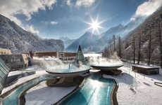 Scenic European Alpine Retreats - The Traditional Aqua Dome Retreat Reflects the Rocky Mountains