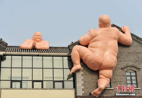 Colossal Religious Figure Sculptures - Two Giant Naked Buddhas Scale a Building in China