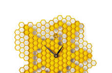 Serene Honeycomb Timepieces - The Busy Bee Wall Clock Brings a Part of Nature Indoors