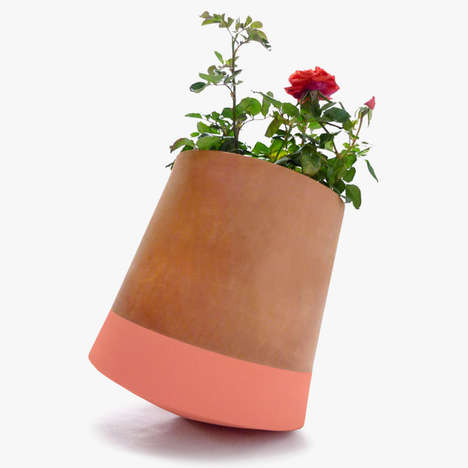 Rolling Flower Pots - These Flower Pots Multiply Plants' Sunlight Exposure and Sway in the Breeze