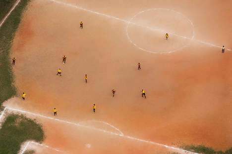 Aerial Soccer Photography - Renato Stockler Photographs Brazilians Playing on Reddish Pitches