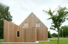 Inverted Wooden Extensions - The House ADN Features an Extension with a V-Shaped Roof