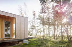 Timber Summer Houses - This Wooden Summer House Sits Perched in the Swedish Woodland