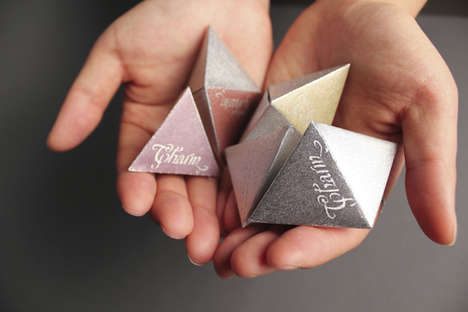 Triangular Chocolate Packaging - Charm Chocolate is Bite-Sized and Perfect for On-the-Go Enjoyment