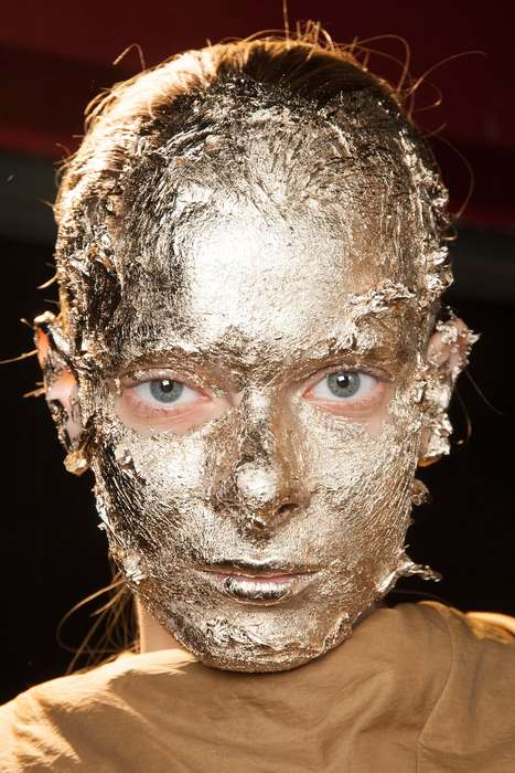 Metallic Foiled Makeup - The Rick Owens Gold Faces Glistened Down the Mayan-Inspired Runway