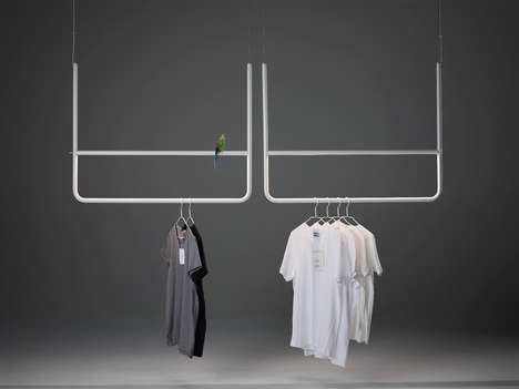 The Hank D75 Illuminants Piece Triples as a Lamp, Clothes Rack and Piece