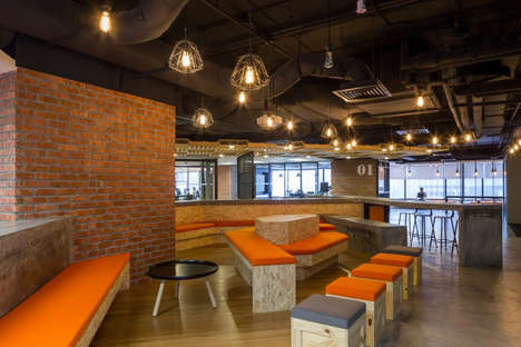 Rustic Open Concept Offices - This Brick and Wood Office is a Collaborative Work Environment