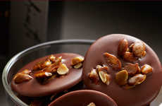 Chocolate Seed Medallions - This Treat Combines Pumpkin Seeds and Chocolate in a Delicate Form