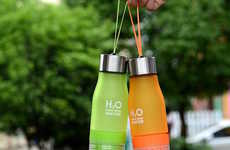 Juicer Water Infusers - The Fruit Juicer Bottle Allows Fresh Juice to be Squeezed on Demand