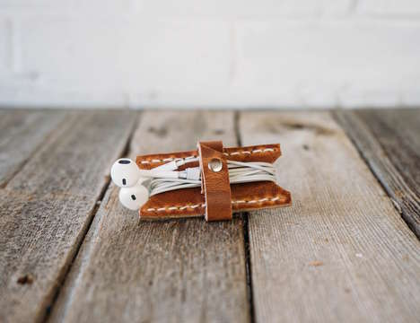 Leather-Bound Earbud Holders - This Headphone Keeper by Stock & Barrel Co Keeps Cords Untangled