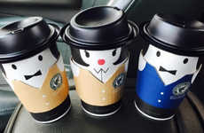 Dressed-Up Coffee Cups - Café Adagio's To-Go Cafe Cups are Personified with Stylish Accessories
