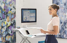 Smooth Standing Desks - The Lotus Sit-Stand Workstation Adjusts Easily for Added Versatility