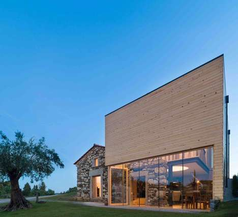 Quinta do Fortunato is a Modern House Built Around an Old Stone Building