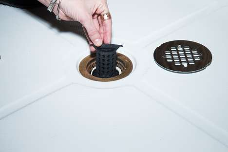 Clog-Deterring Drain Filters - The 'ShowerShroom' Drain Hair Catcher Makes Cleaning a Cinch