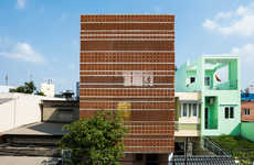 Intricate Terracotta Facades - 'Apartment in Binh Thanh' Features a Detailed Red Exterior