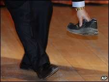 Protesting With Footwear - Tibet Activists Throws Shoe At China Premier In The UK