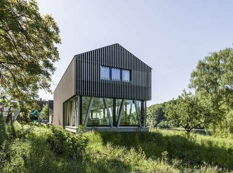 Faux-Stilted Country Cottages - Hemishofen House Features Illusive Columns on the Ground Floor