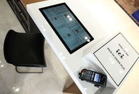 Digital Handbag Kiosks - Galeries Lafayette is Simplifying Bag Shopping with NFC Tags and Tables