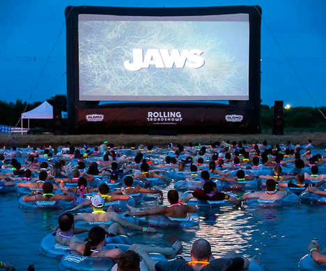 Floating Aquatic Movie Screenings - JAWS On The Water Has Guests on Inner Tubes While Watching