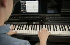 Easy-to-Learn Pianos - The Yamaha Clavinova Piano Flashes Lights Above Keys to Quicken Learning